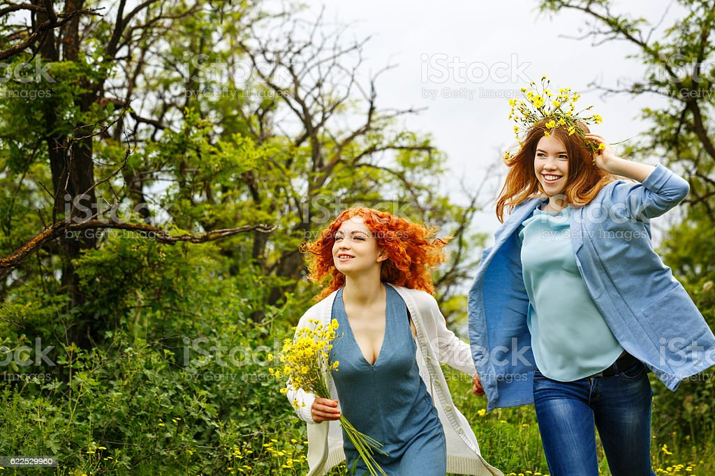 Girlfriends walking in the park. stock photo