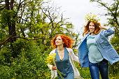Girlfriends walking in the park.