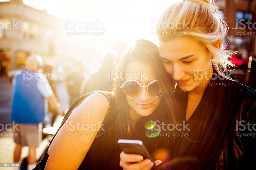 Girlfriends with a smartphone stock photo
