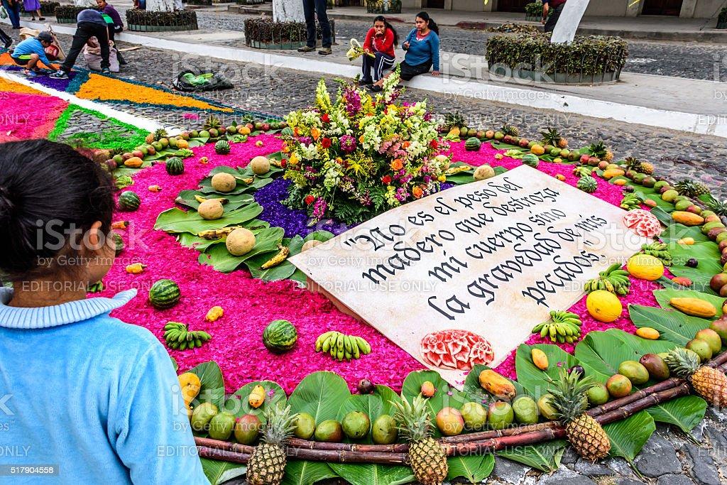 Girls admires Palm Sunday carpet, Antigua, Guatemala stock photo