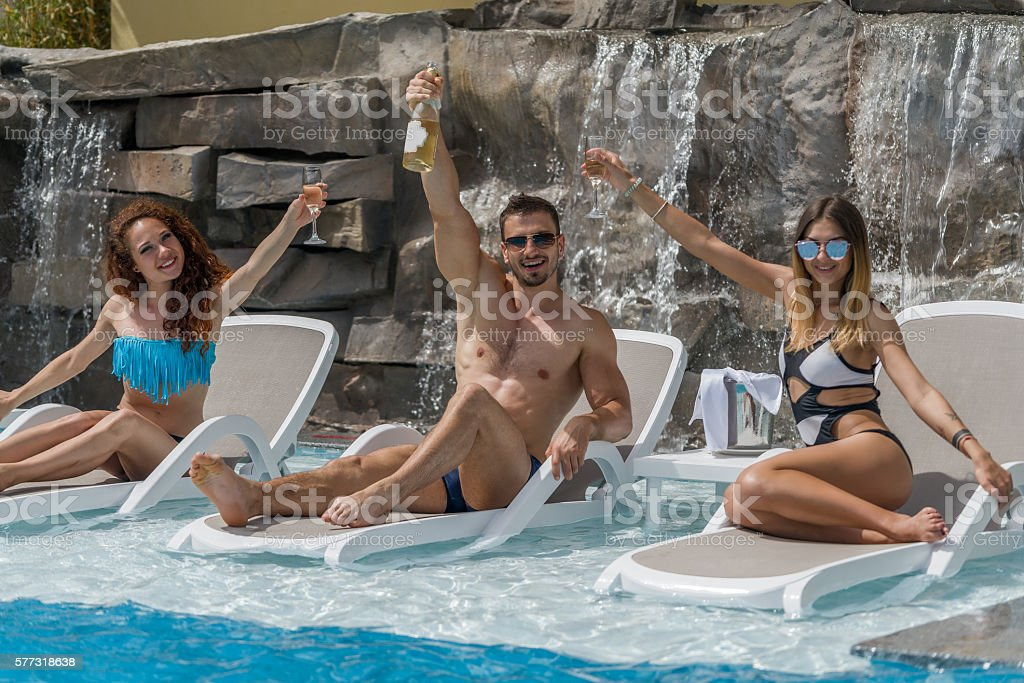 girls and boy drinking stock photo