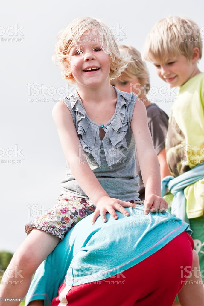 girls and boys playing outdoors together having fun stock photo
