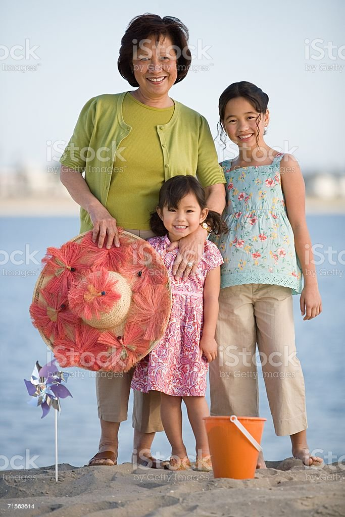 Girls and grandmother by the sea royalty-free stock photo