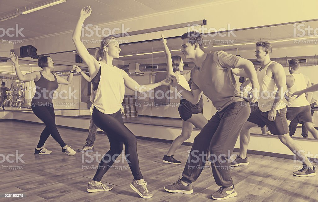 Girls and men learning swing stock photo