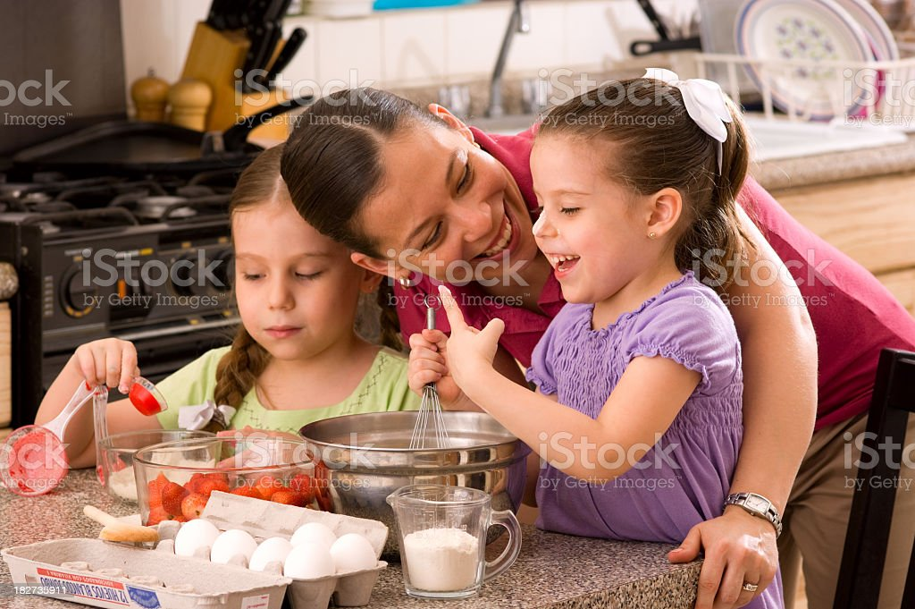 Girls and Mom at the Kitchen stock photo