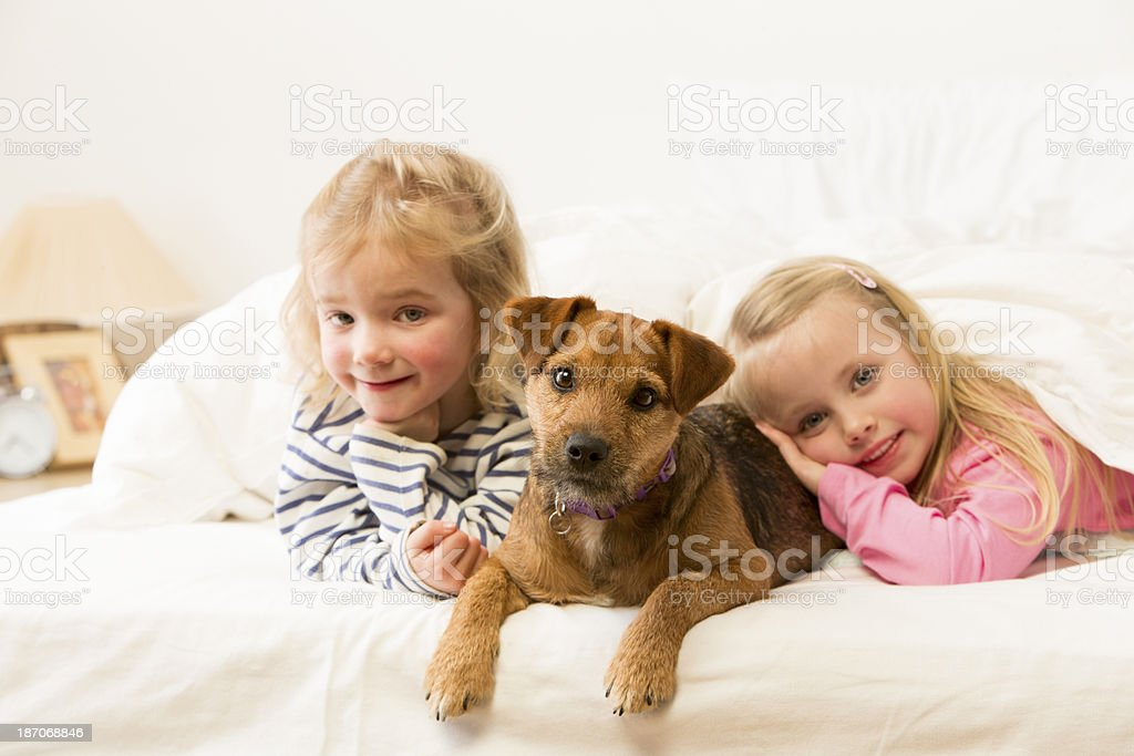 Girls and Their Dog royalty-free stock photo