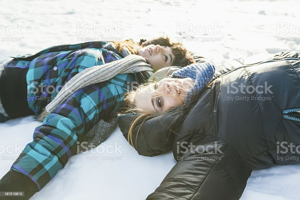 Girls are having fun with the snow royalty-free stock photo
