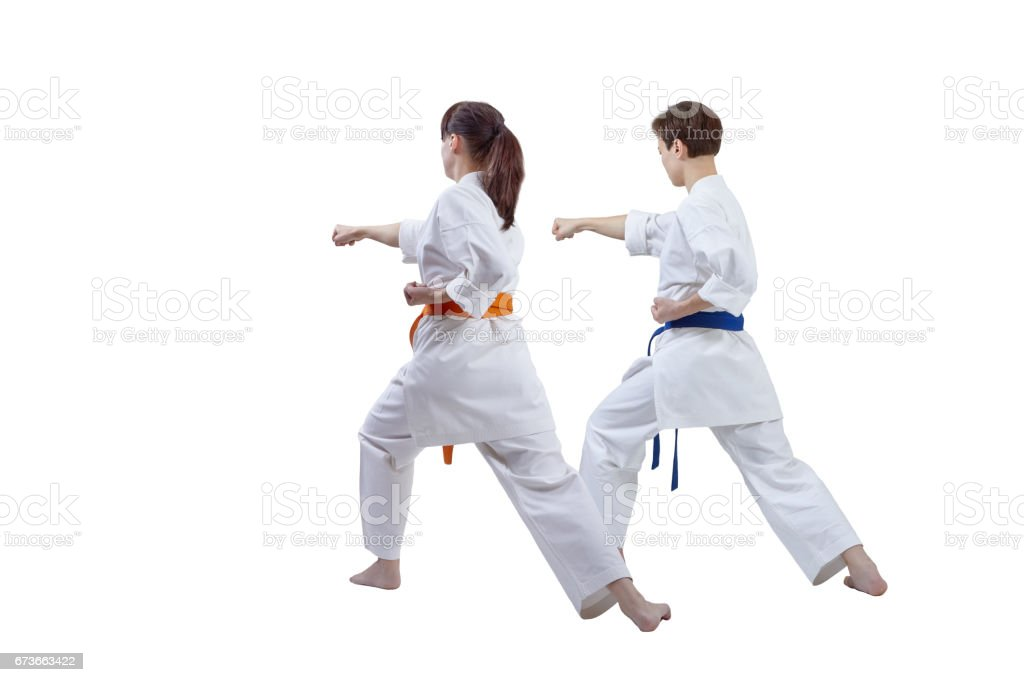 Girls are training punch hand against a white background stock photo