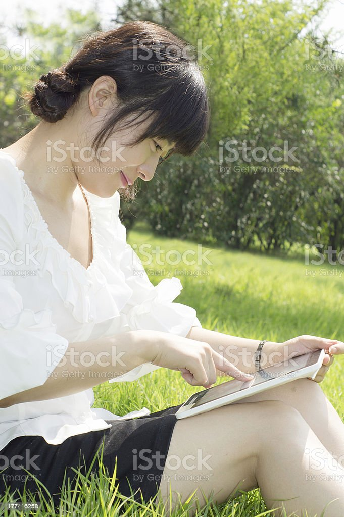 Girls are using Tablet PC royalty-free stock photo