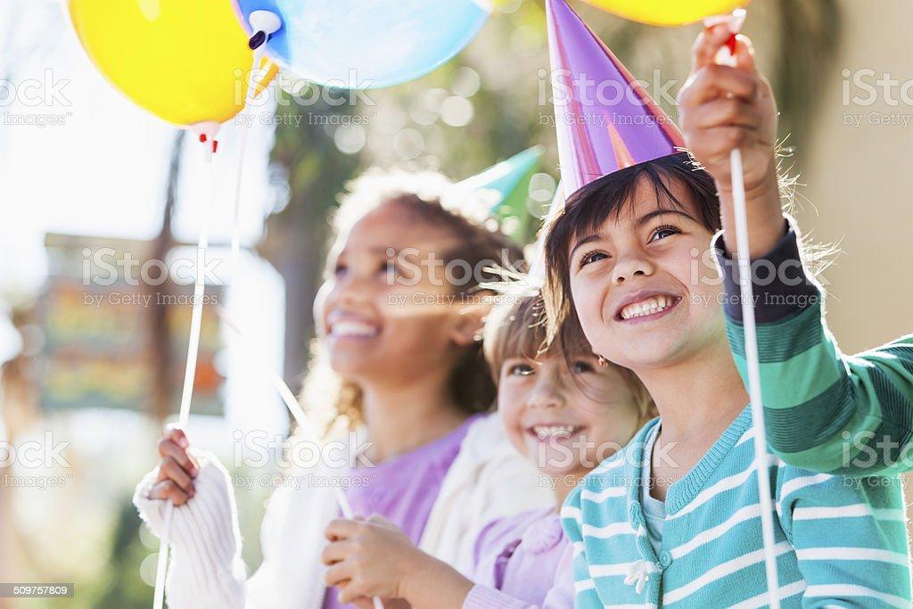 Girls at birthday party stock photo