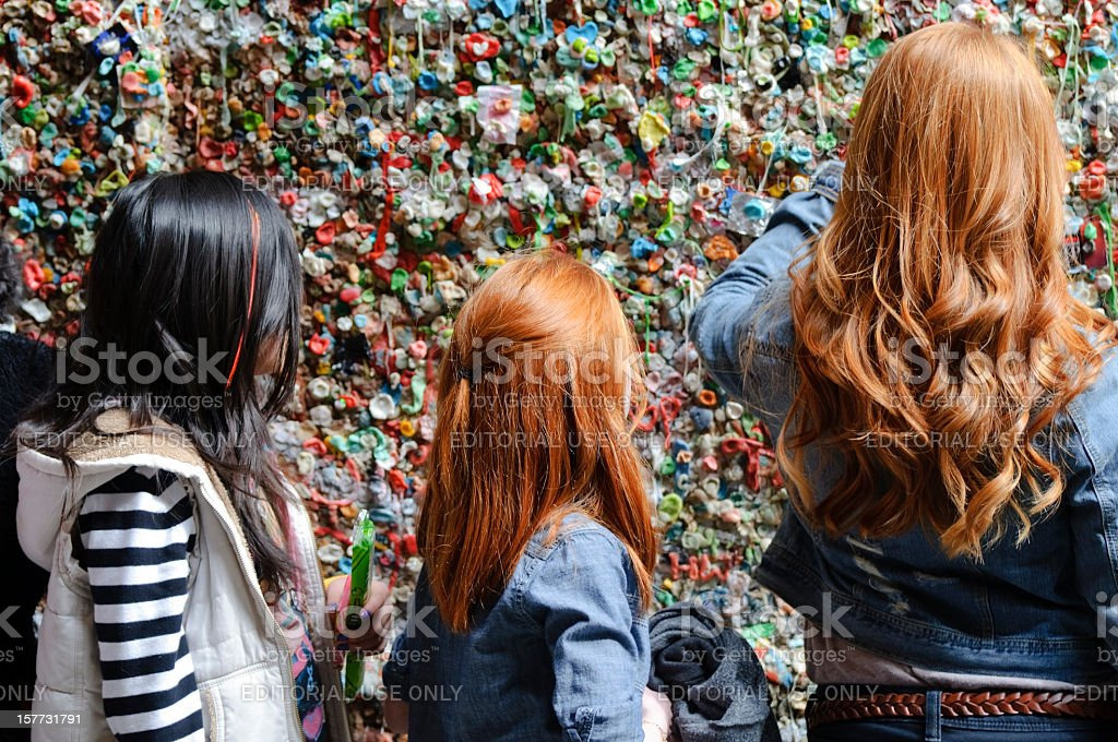 Girls at the Gum Wall - Pike Place, Seattle stock photo