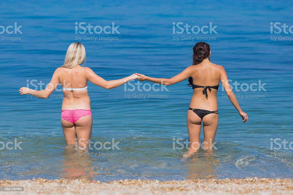 Girls at the sea stock photo