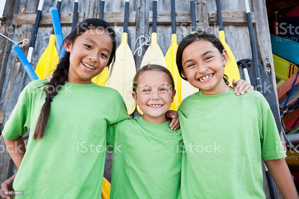 Girls at water sports equipment center stock photo