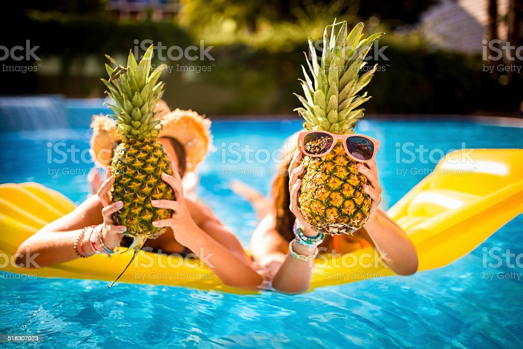 Girls Being Silly in Pool stock photo