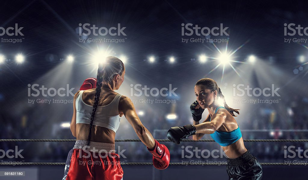 Girls boxing in ring . Mixed media stock photo