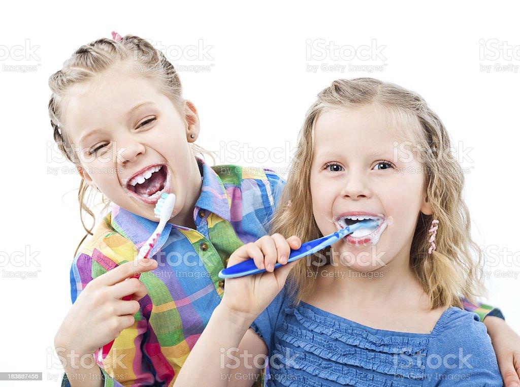 Girls brushing teeth royalty-free stock photo