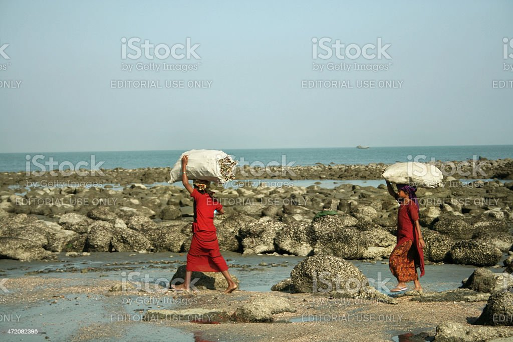 Girls carrying bags stock photo
