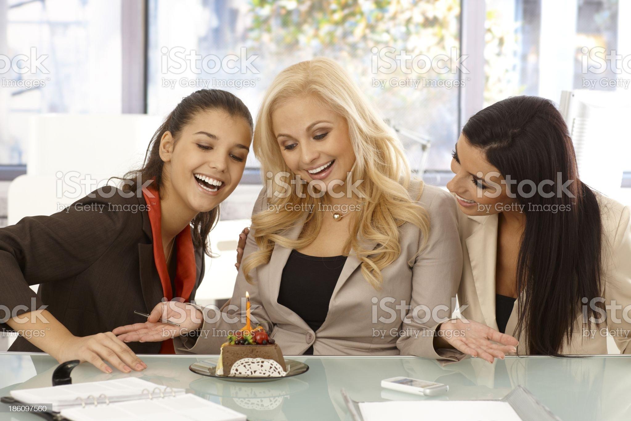 Girls celebrating birthday at workplace royalty-free stock photo