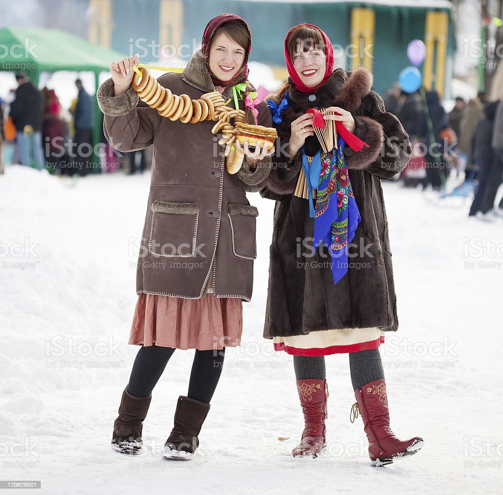 girls celebrating  Shrovetide  at Russia royalty-free stock photo