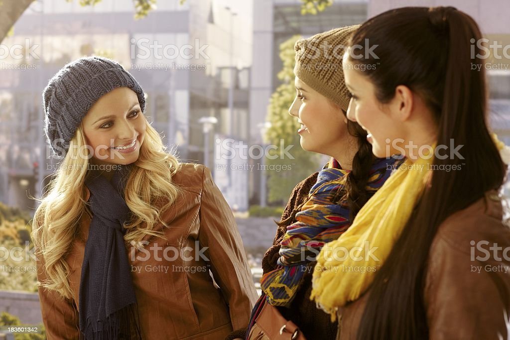 Girls chatting and walking outdoors royalty-free stock photo