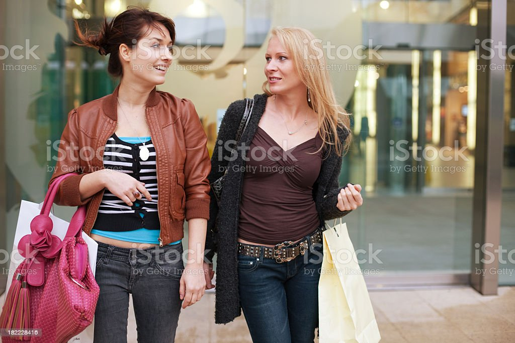 Girls coming from shopping royalty-free stock photo
