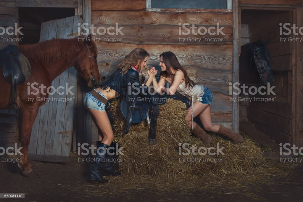 Girls cowboys fight on their hands. stock photo