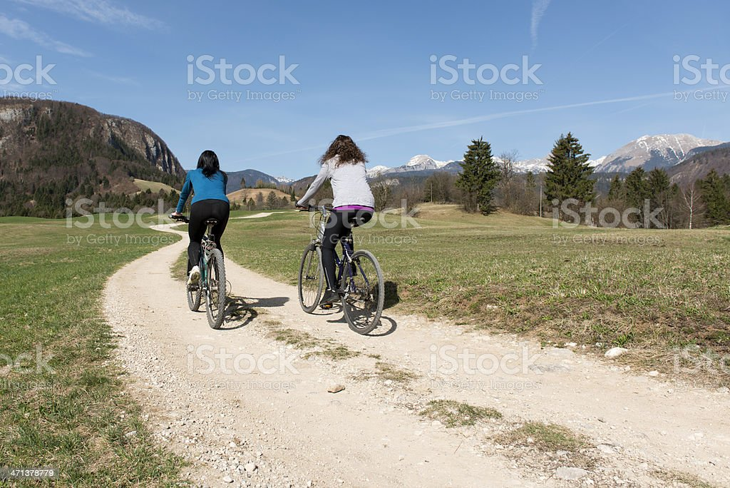 Girls cycling royalty-free stock photo