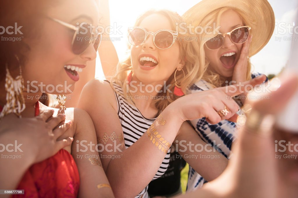 Girls delighted with taken photo stock photo