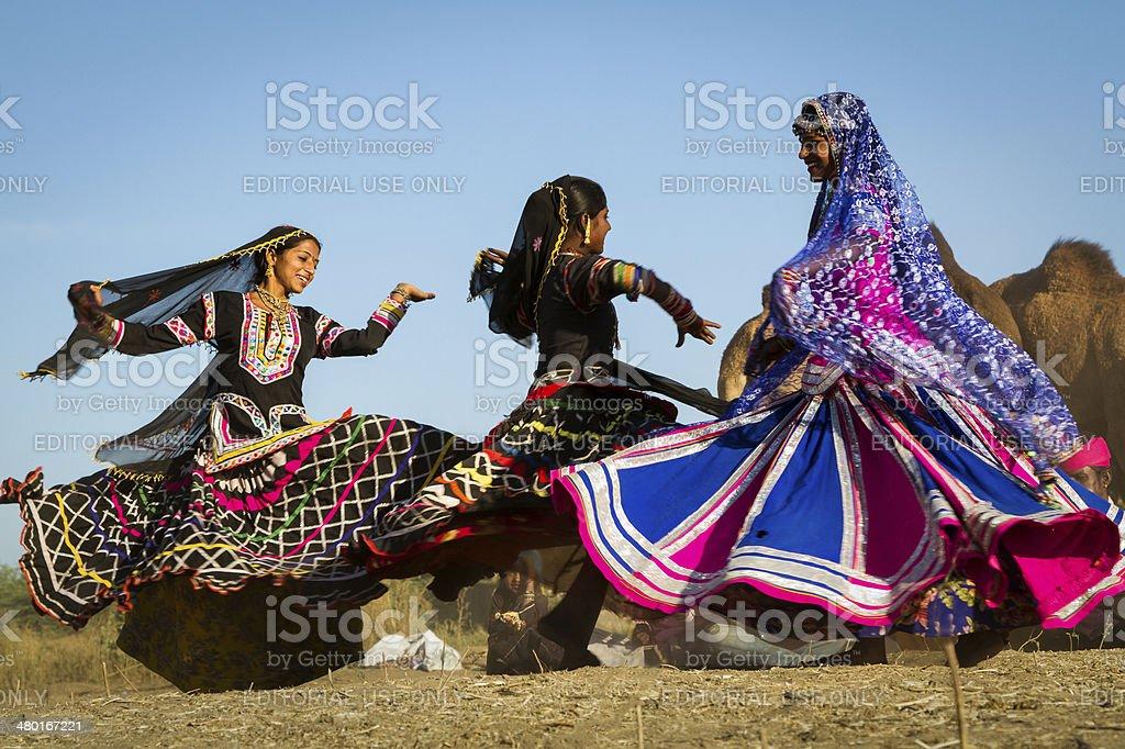 Girls doing folk dance at Pushkar Fair stock photo