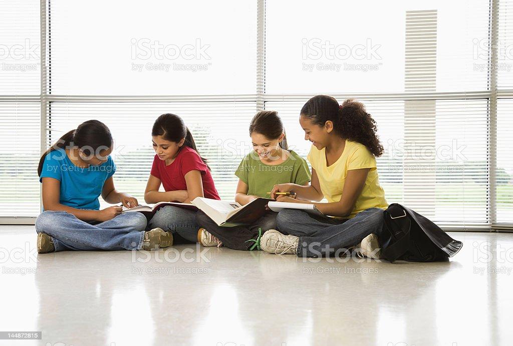 Girls doing homework. royalty-free stock photo