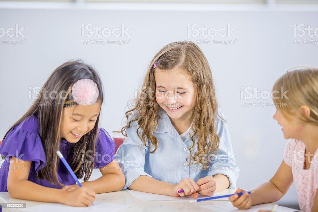 Girls Doing Spelling Homework stock photo