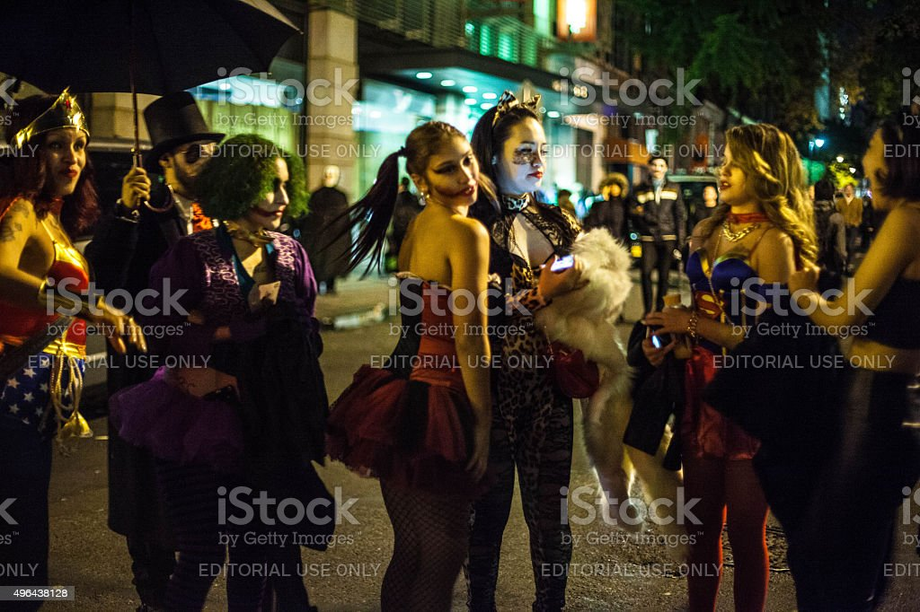 Girls dress up as vixens and villains for Halloween night. stock photo