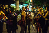 Girls dress up as vixens and villains for Halloween night.