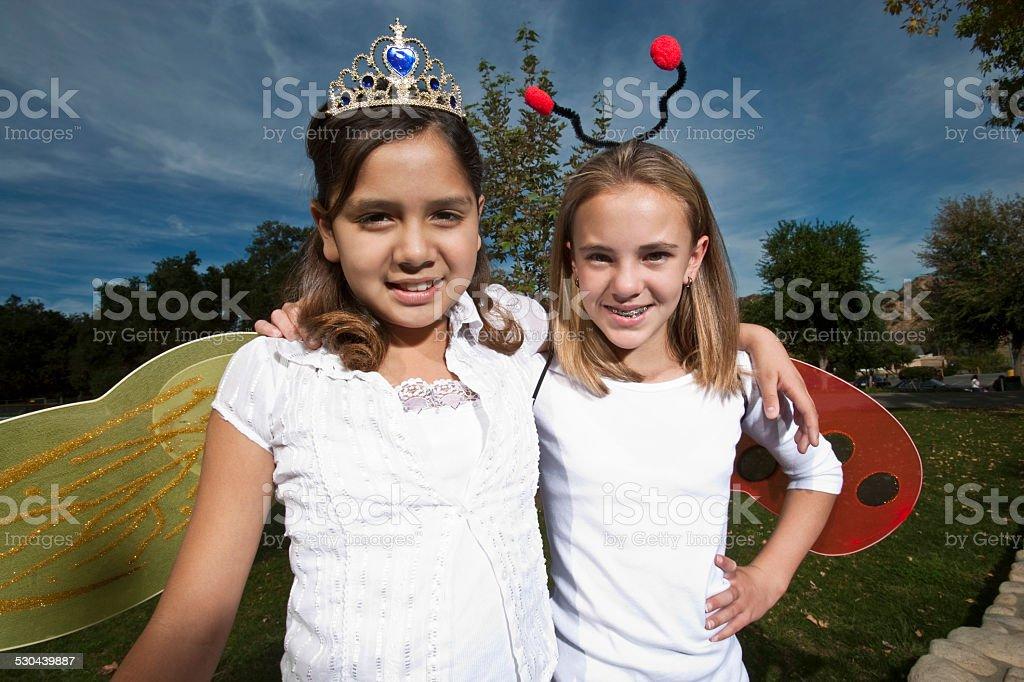 Girls Dressed As Ladybug And Angel stock photo