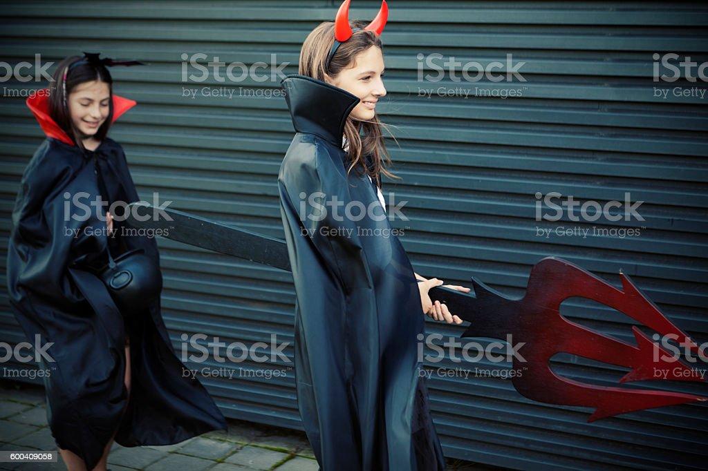 Girls dressed for Halloween having fun stock photo