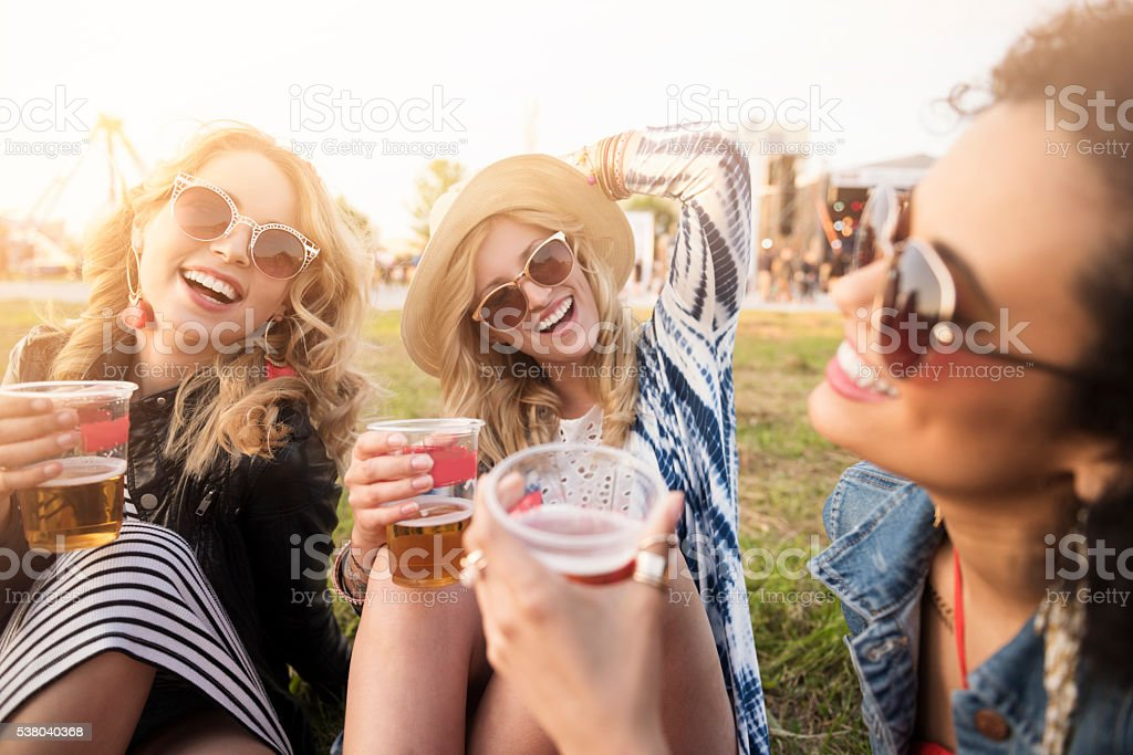 Girls drinking beer in front of the stage stock photo