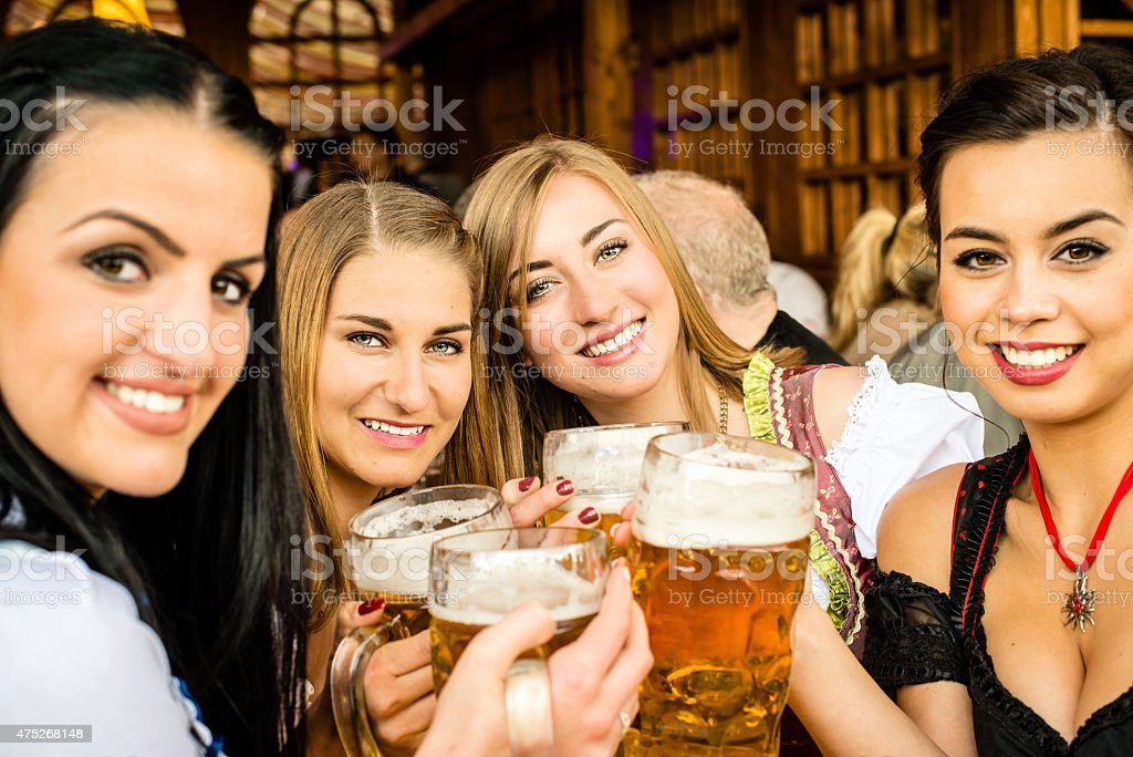 Girls drinking beer stock photo