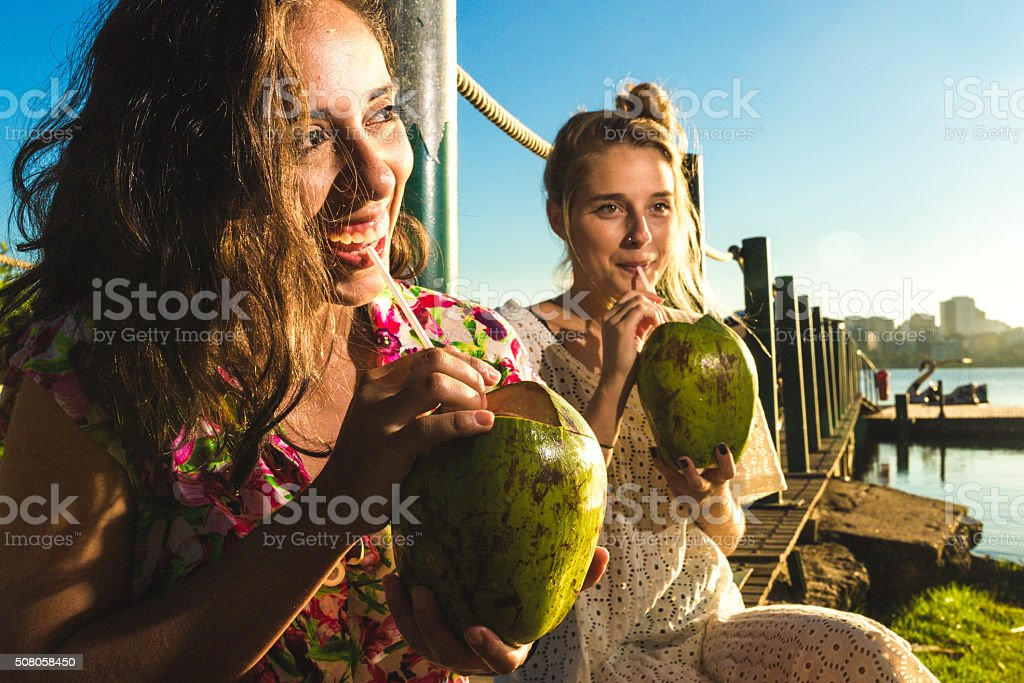 Girls drinking coconut water stock photo