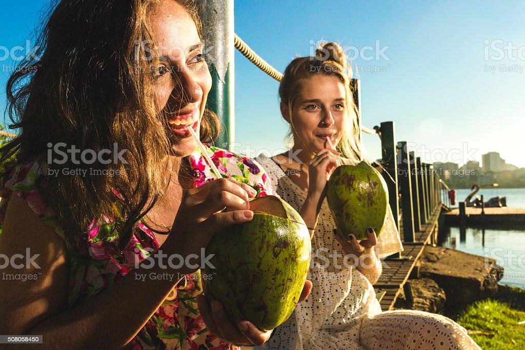 Girls drinking coconut water stock photo