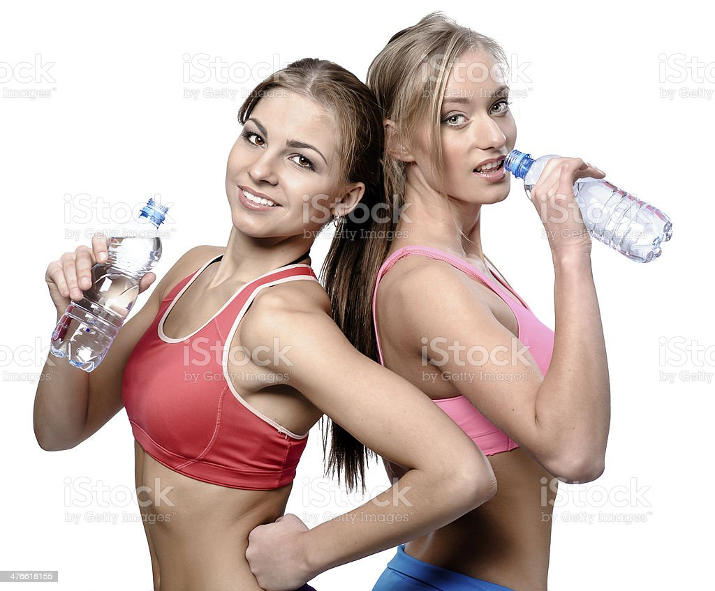 Girls drinking water after fitness exercise royalty-free stock photo
