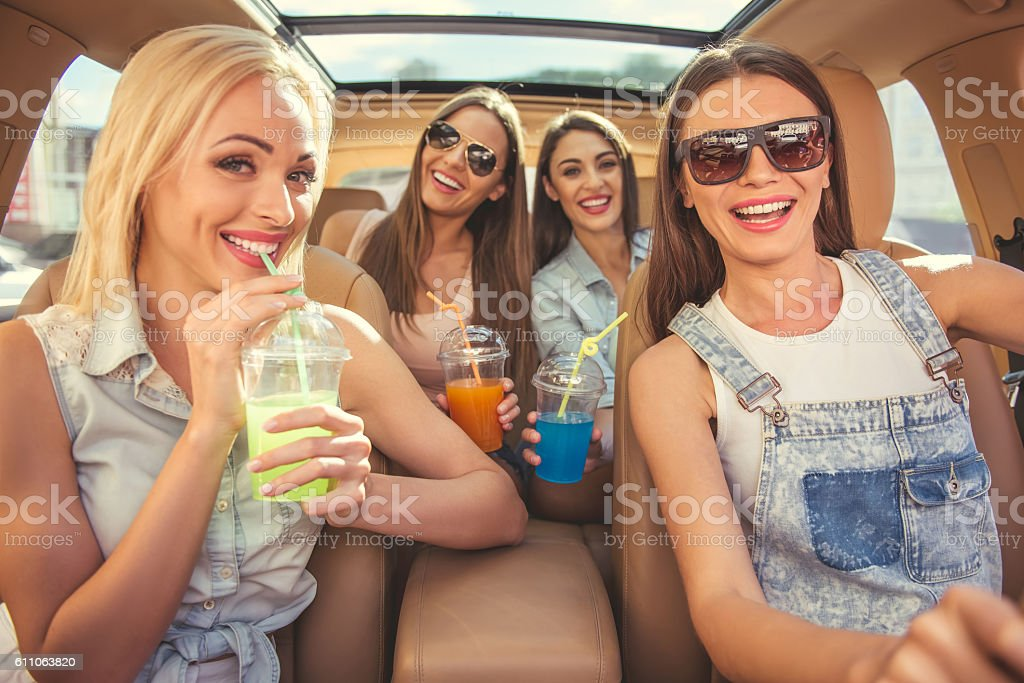 Girls driving the car stock photo