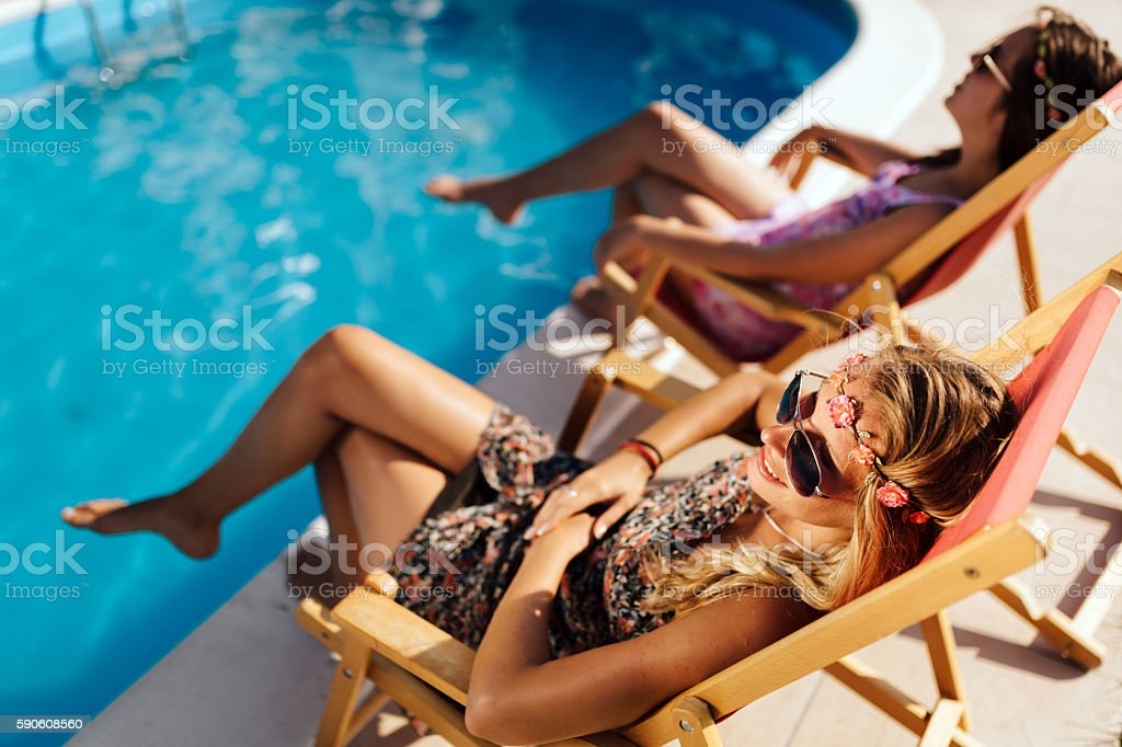 Girls enjoying summer vacation in chairs stock photo