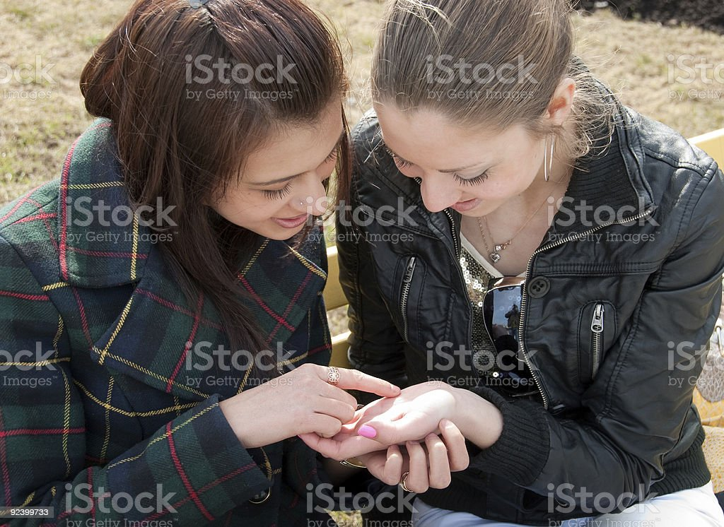 Girls examine lines on a palm stock photo