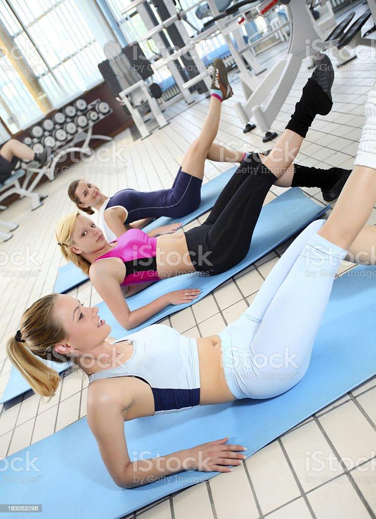 Girls exercising in gym. royalty-free stock photo