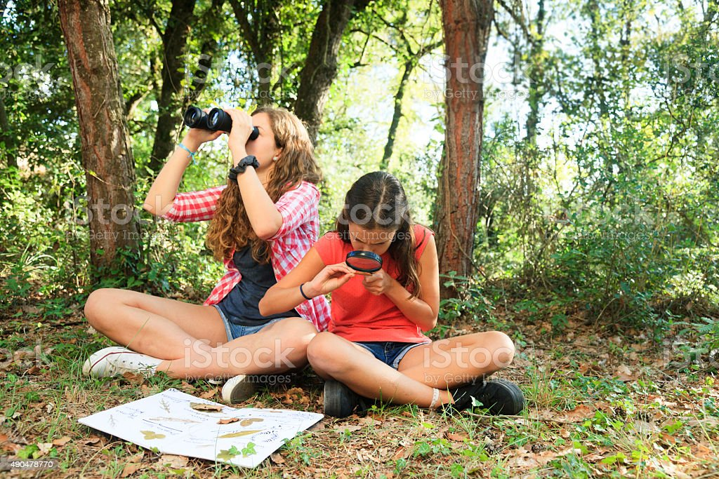 Girls exploring nature stock photo