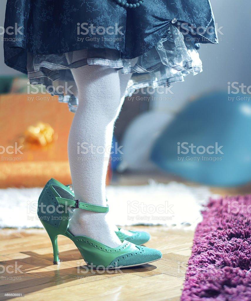 Girls Feet in Mum's Shoes stock photo