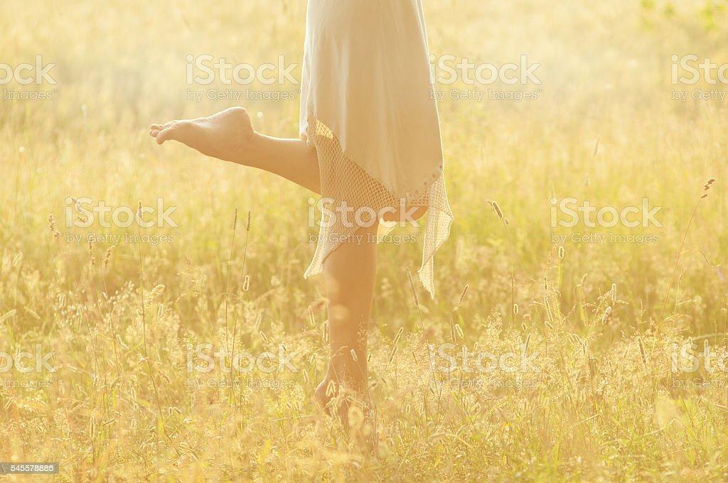 girl's feet on a summer meadow stock photo