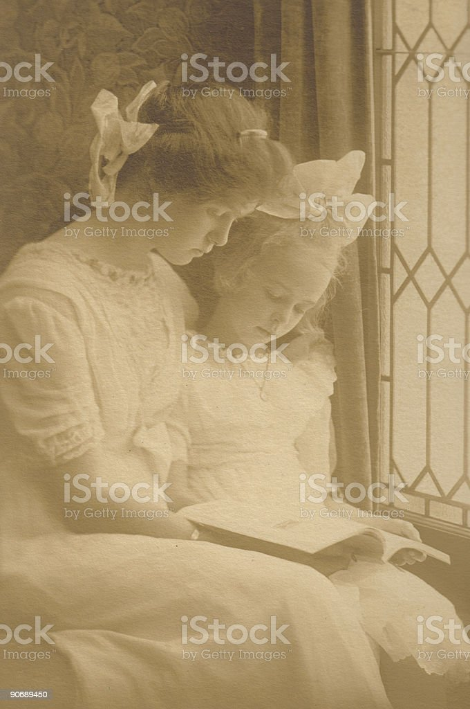 Girls from 1800's with Book royalty-free stock photo