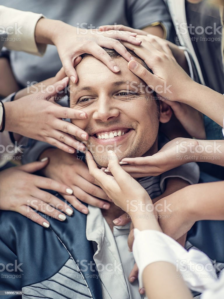 Girls Get Crazy For Young Man stock photo