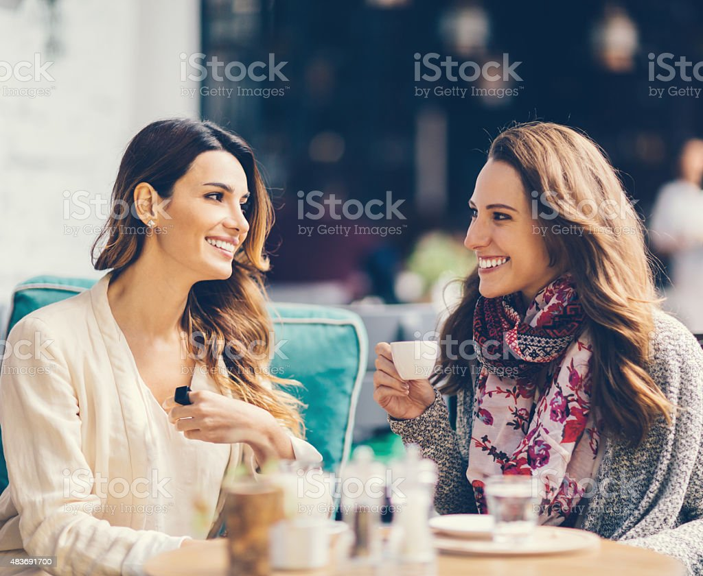 Girls gossiping at outdoors cafe in Istanbul stock photo